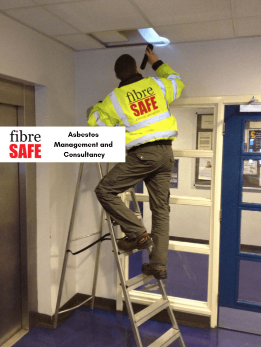 Fibre Safe worker working on ceiling in school