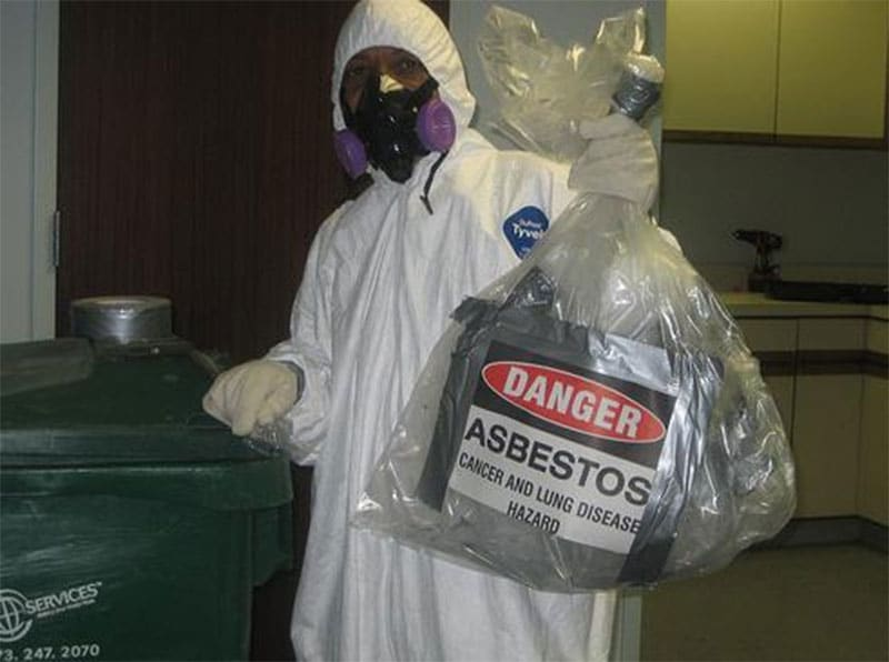 Fibre Safe employee with bagged up asbestos