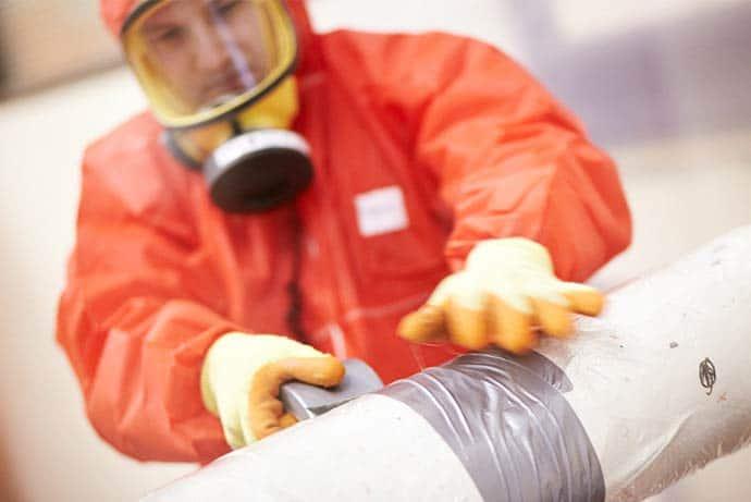Fibre Safe worker in hazmat suit - background image