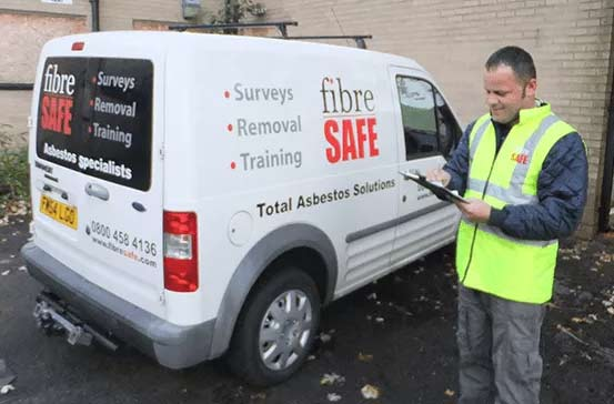 Fibre Safe worker with clipboard and van
