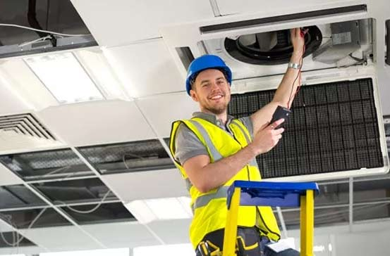 Fibre Safe worker working on ceiling