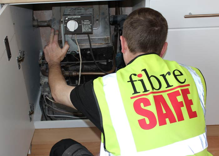 Fibre Safe employee carrying out survey on boiler in Warrington house