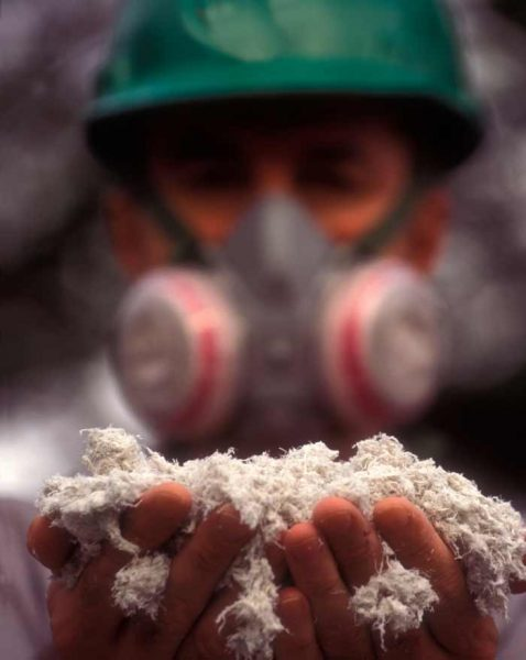 Masked Fibre Safe worker with Asbestos
